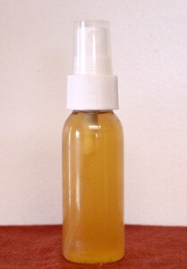 small bottle of yellow fluid for reducing itch in dogs