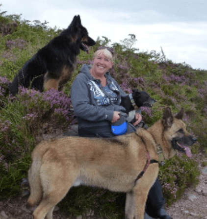 A photo of Jo Arbon with her dogs