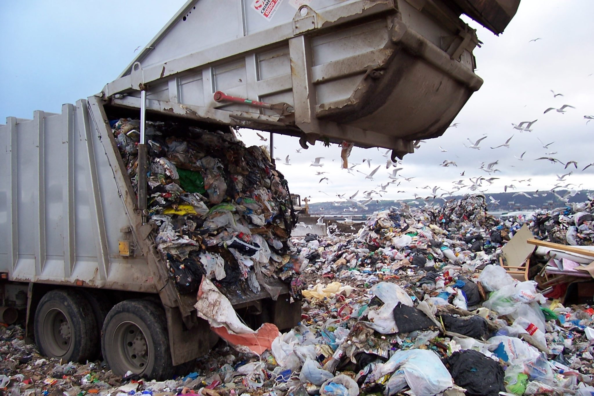 image of a truck dumping rubbish into a land fill